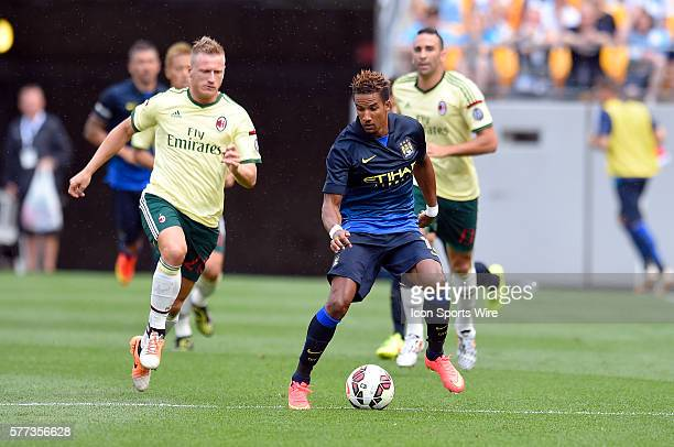 Manchester City midfielder Scott Sinclair plays the ball in front of AC Milan defender Ignazio Abate during the second half in the International...