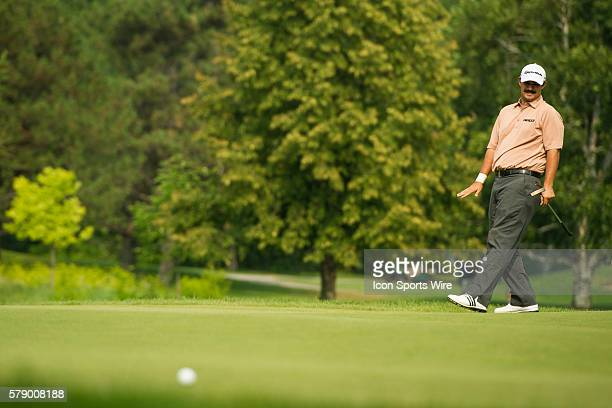 Mark Wilson reacts after missing a putt on the 5th hole during the second round of the 2014 RBC Canadian Open at the Royal Montreal Golf Club in Ile...