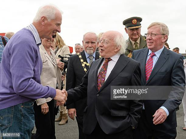 30 July 2014 President of Ireland Michael D Higgins is greeted by Martin Garry from Partry Co Mayo after arriving for thew days races with manager of...