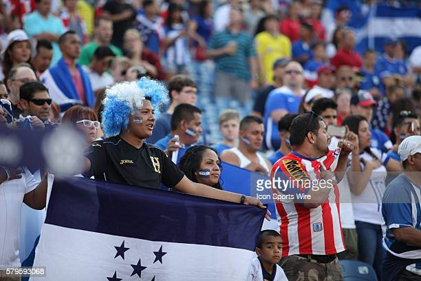 A Honduras fan displays the flag The Men's National Team of Honduras and the Men's National Team of Panama drew 11 in a CONCACAF Gold Cup group stage...