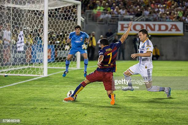 Barcelona forward Pedro shoots past Los Angeles Galaxy defender Dan Gargan during the International Champions Cup game between FC Barcelona and LA...