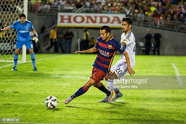 Barcelona forward Pedro works against Los Angeles Galaxy defender AJ DeLaGarza during the International Champions Cup game between FC Barcelona and...