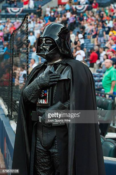 Darth Vader from the Star Wars 501st Legion take stands for the National Anthem as the members before a regular season game between the Philadelphia...
