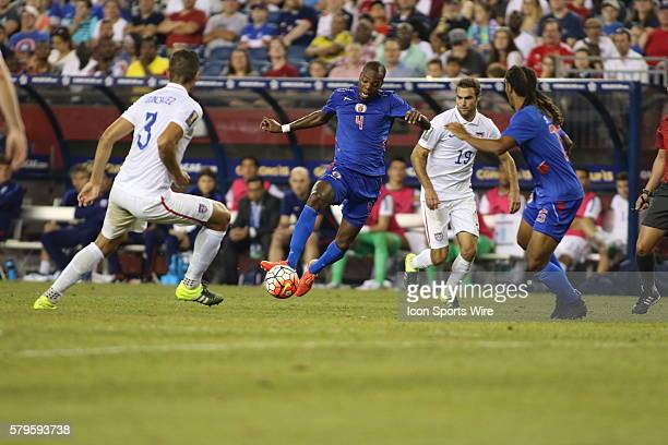 Haiti defender Kim Jaggy makes a move on United States defender Omar Gonzalez and United States midfielder Graham Zusi during play on friday The...