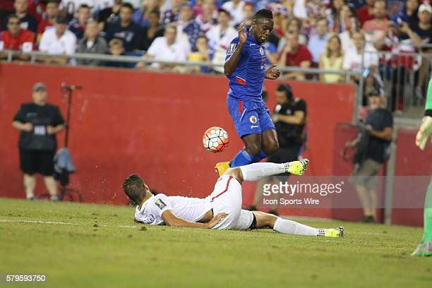 Haiti forward Jean Eudes Maurice jumped over United States defender Omar Gonzalez during play The Men's National Team of the United States defeated...