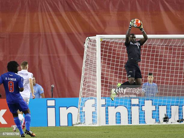 Haiti goalkeeper Johnny Placide jumps to make a save The Men's National Team of the United States defeated the Men's National Team of Haiti 10 in a...