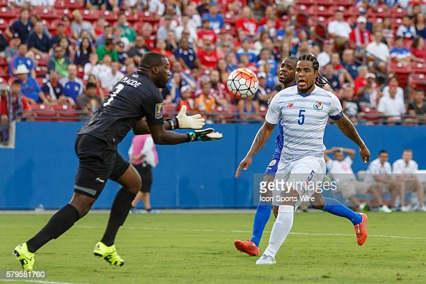Haiti goalkeeper Johny Placide makes a play on the ball in front of a closing Panama defender Roman Torres during CONCACAF Group A Gold Cup match...
