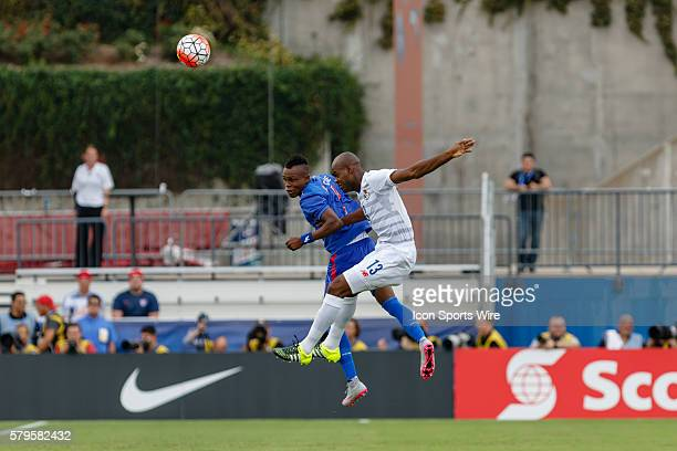 Haiti midfielder WildeDonald Guerrier and Panama defender Adolfo Machado battle for a header during CONCACAF Group A Gold Cup match between Panama...