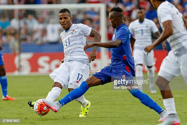 Haiti midfielder WildeDonald Guerrier stretches to block a pass by Panama defender Luis Henriquez during CONCACAF Group A Gold Cup match between...
