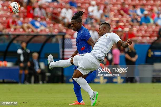 Panama defender Harold Cummings clears a ball in front of Haiti forward Kervens Belfort during CONCACAF Group A Gold Cup match between Panama and...