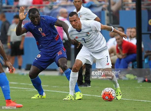 Panama forward Blas Perez tries to hold off Haiti midfielder JeanMarc Alexandre during the Gold Cup Group Stage match between Panama and Haiti at...