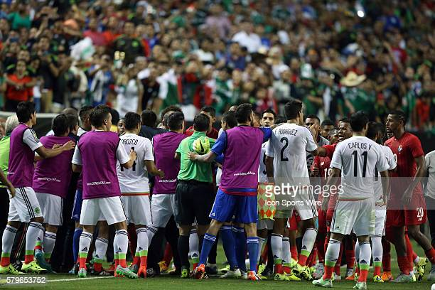 Players and staff from both teams get involved in a melee on the sideline after Mexico had been awarded a penalty kick late in regulation The Panama...