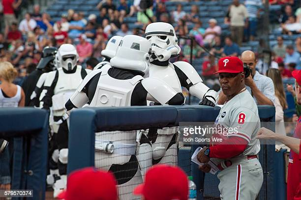 Stormtroopers from the Star Wars 501st Legion take talking with Philadelphia Phillies First Base Coach Juan Samuel before a regular season game...