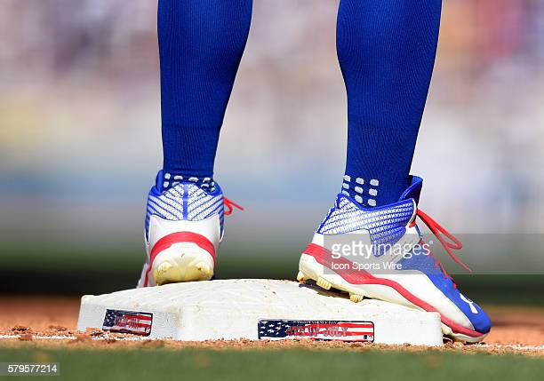 The cleats of Los Angeles Dodgers Center field Joc Pederson [8776] while standing on 3rd base that contains the 4th of July logo and American flag...