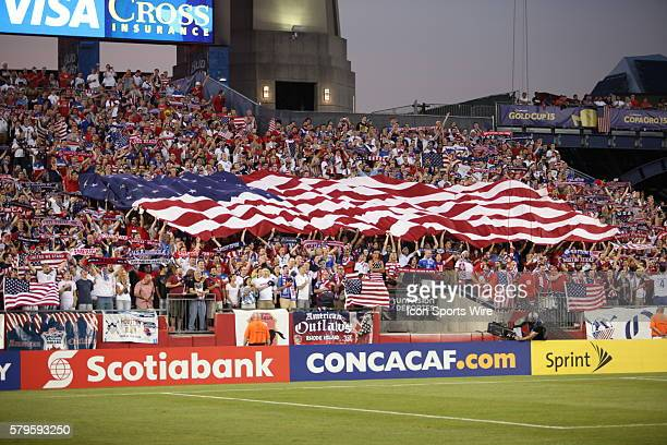 The flag soars across the crowd The Men's National Team of the United States defeated the Men's National Team of Haiti 10 in a CONCACAF Gold Cup...