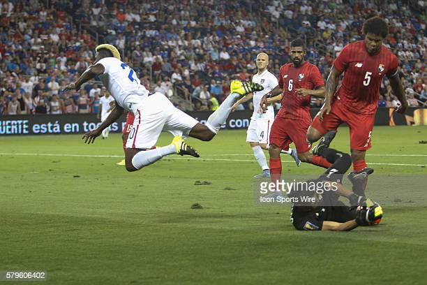 United States midfielder Gyasi Zardes gets tackled by the Panama goalkeeper during the CONCACAF Gold Cup Group Stage at Sporting Park Kansas City KS...