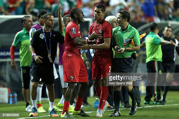 Valentin Pimentel tries to push teammate Luis Tejeda away from the Mexico bench and Assistant Referee Philippe Briere after Tejeda had received a red...