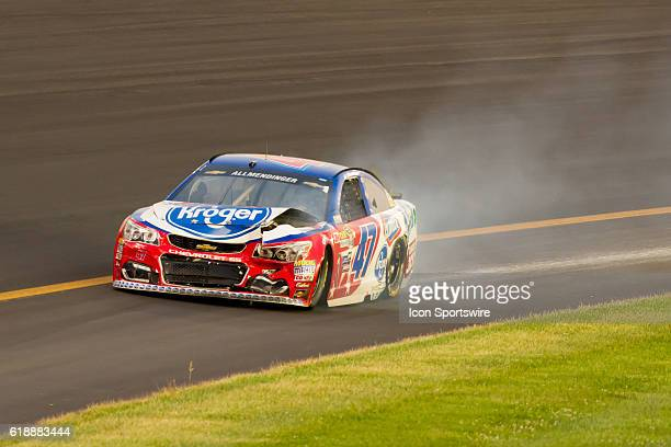AJ Allmendinger pulls off the track after a crash during the NASCAR Sprint Cup Series Quaker State 400 at Kentucky Speedway in Sparta KY
