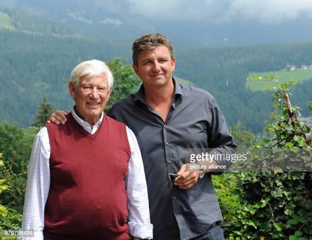 Actor Siegried Rauch and Hans Sigl take a break on the set of 'Der Bergdoktor' Photo Ursula Düren/dpa
