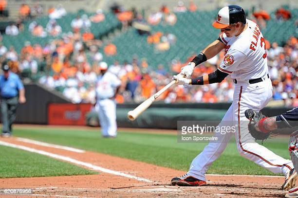 Baltimore Orioles third baseman Ryan Flaherty singles against the Cleveland Indians at Orioles Park at Camden Yards in Baltimore MD where the...
