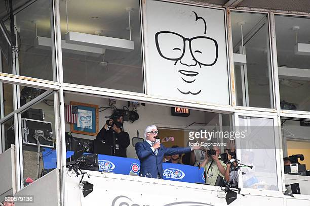 Ex Chicago Cubs Ryan Dempster dressed up as Harry Caray sings the seventh inning stretch during a game between the Texas Rangers and the Chicago Cubs...