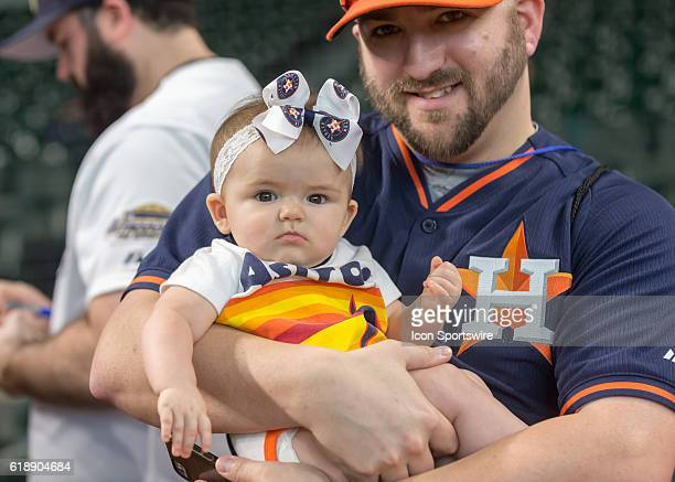 Houston Astros baby fan and dad wait for players to sign autographs during the MLB game between the Chicago White Sox and Houston Astros at Minute...