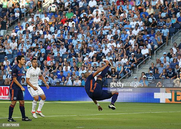 New York City FC defender Jason Hernandez completes a bicycle kick to clear a ball in a match between New York City FC and Sporting Kansas City at...