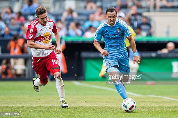 New York City FC defender RJ Allen brings the ball up defended by New York Red Bulls midfielder Alex Muyl during the second half of the MLS match...