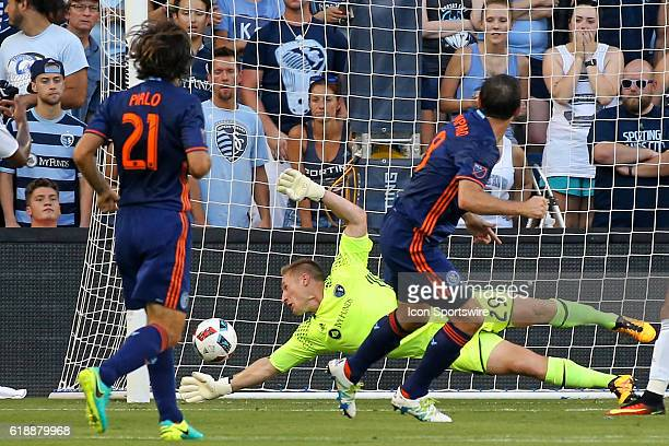 New York City FC midfielder Frank Lampard gets the ball past Sporting Kansas City goalkeeper Tim Melia for a first half goal in a match between New...