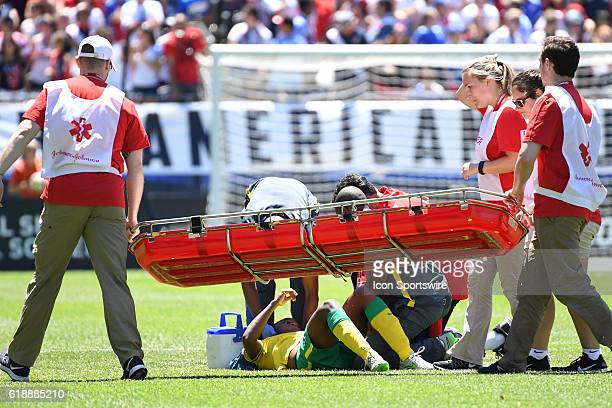 South Africa forward Shiwe Nogwanya is taken off the field after an injury during a game between South Africa and USA at Soldier Field in Chicago IL