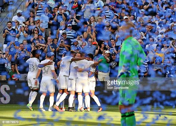 Sporting KC celebrates midfielder Jimmy Medranda first MLS goal while New York City FC goalkeeper Josh Saunders stands amongst blue confetti in the...