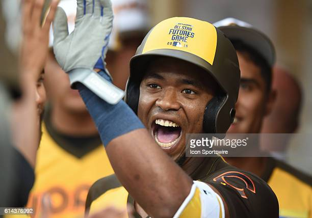 Team World Eloy Jimenez celebrates with his team mates after hitting a home run during the MLB AllStar Futures Game at PETCO Park in San Diego CA