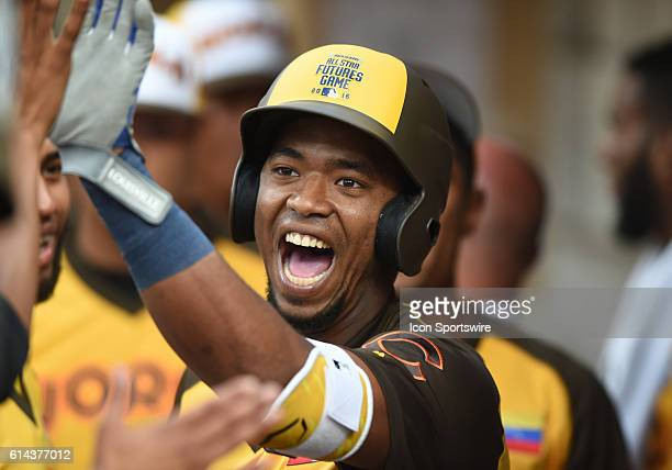 Team World Eloy Jimenez celebrates with his team mates after hitting a home run during the MLB All-Star Futures Game at PETCO Park in San Diego, CA.