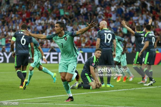 July 2016 - UEFA EURO 2016 - Semi Final - Portugal v Wales - Dejected Wales players look on as Cristiano Ronaldo of Portugal celebrates scoring their...