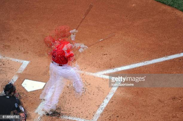 Washington Nationals shortstop Danny Espinosa hits a single in an in camera multiple exposure against the Milwaukee Brewers at Nationals Park in...