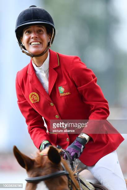 CHIO equestrian show jumping The Portuguese rider Luciana Diniz riding on horse Fit For Fun laughs during the second round at the Grand Prix of...