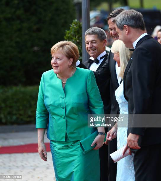 Federal Chancellor Angela Merkel of the Christian Democratic Union arrives with her Husband Joachim Sauer Markus Söder of the Christian Social Union...