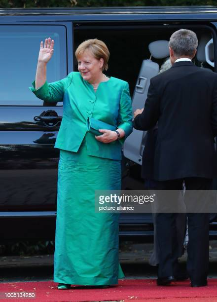 Federal Chancellor Angela Merkel of the Christian Democratic Union arrives with her Husband Joachim Sauer to the Premiere at the Fesitval House The...
