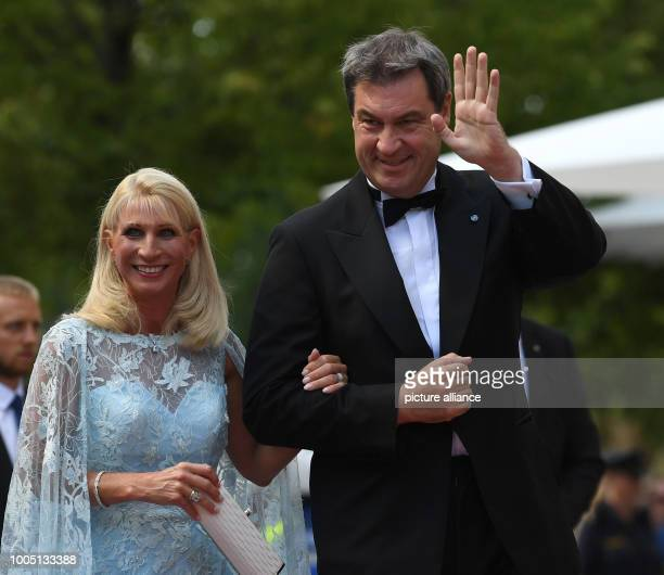 Markus Soeder Prime Minister of Bavaria and his wife Karin arrive to the Premiere of the Festival The Richard Wagner Festival 2018 begins with the...