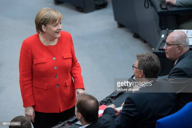 Federal Chancellor Angela Merkel of the Christian Democratic Union speaks at the plenary session in the German Bundestag with Volker Kauder chairman...