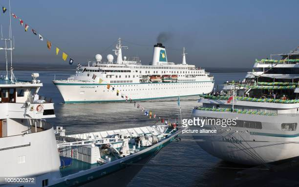 The cruise ship 'Deutschland' passes the already moored 'Amadea' and 'Albatros' to moor at the Columbus quay Four cruise ships are expected on the...