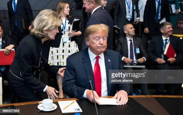 Kay Bailey Hutchison United States Permanent Representative to NATO speaks with Donald Trump President of the United States of America at the first...