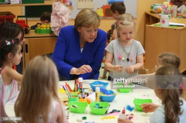 German chancellor Angela Merkel visits the Caritas Centre Kalk and accompanies children during their creative selfexpression NordrheinWestfalen Köln...