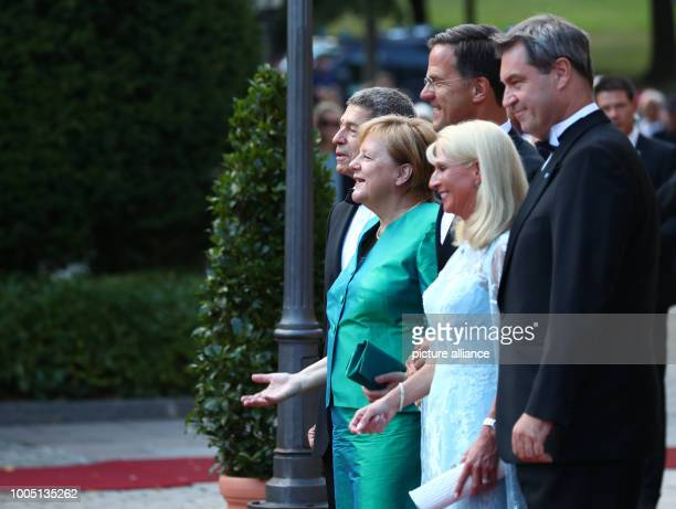 Joachim Sauer and his wife German Chancellor Angela Merkel of the Christian Democratic Union stand next to Dutch Prime Minister Marc Rutte Karin...