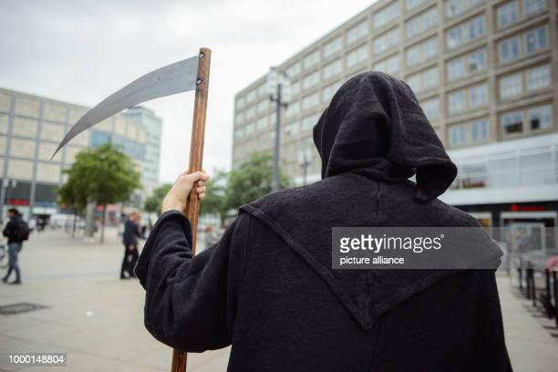 An actor dressed as the Grim Reaper on Alexanderplatz for an advertising campaign of the chamber of horrors Berlin Dungeon The figure of the Grim...