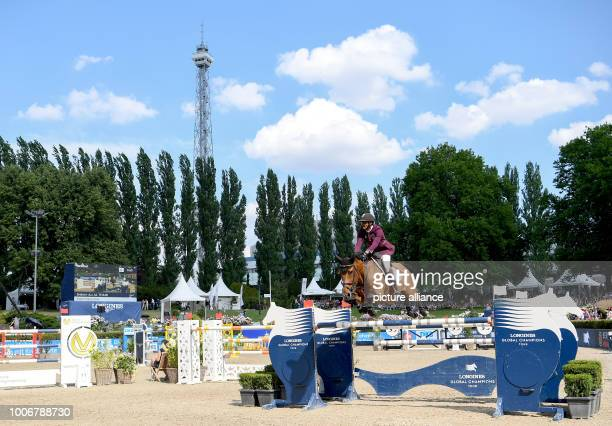 July 2018, Germany, Berlin: equestrian sports/jumping: Global Champions Tour: Sheikh Ali bin Chalid Al Thani on First Devision jumps over an obstacle...