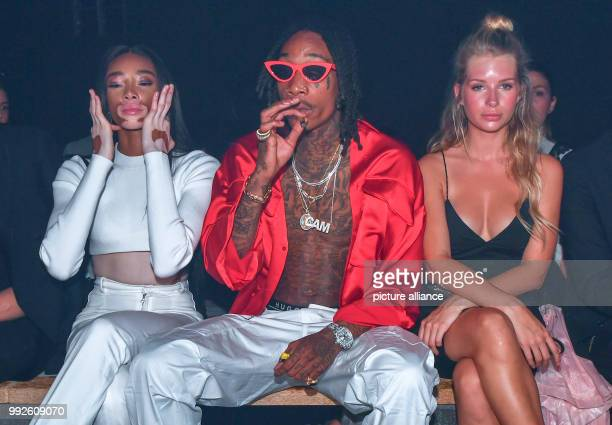 Winnie Harlow Canadian model with a pigment disorder Wiz Khalifa American rapper and Lottie Moss British model and sister of Kate Moss waiting for...