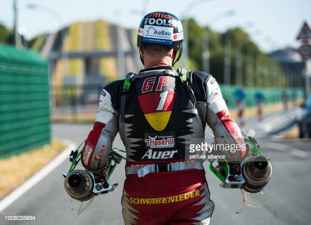 Dirk Auer walks along the test track in a special leather suit and two jet engines on his forearms Auer plastics technology engineer from GroßGerau...