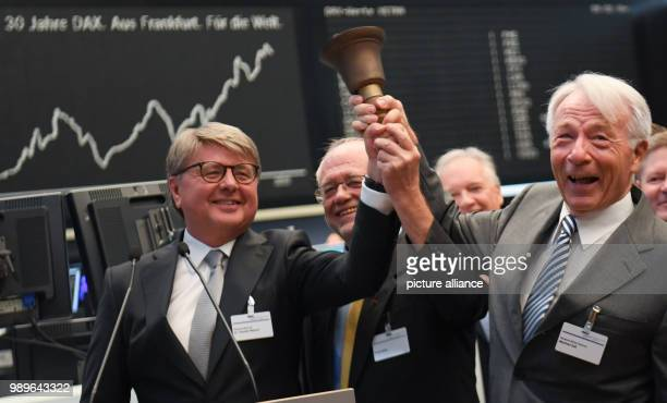 Chairman of the Deutsche Boerse AG Theodor Weimer Frank Mella and Manfred Zass ringing the stock exchange bell on the floor of the Frankfurt stock...