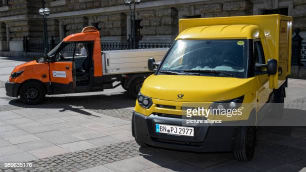 Vehicles from the DHL subsidiary 'Streetscooter' standing on the town hall square The Deutsche Post DHL Group and Hamburg are starting a strategical...